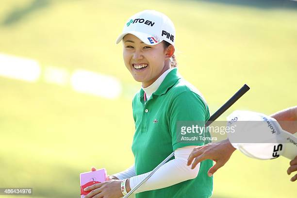 Yoko Maeda of Japan reacts after making her birdie putt on the 18th hole during the first round of the Golf 5 Ladies Tournament 2015 at the Mizunami...