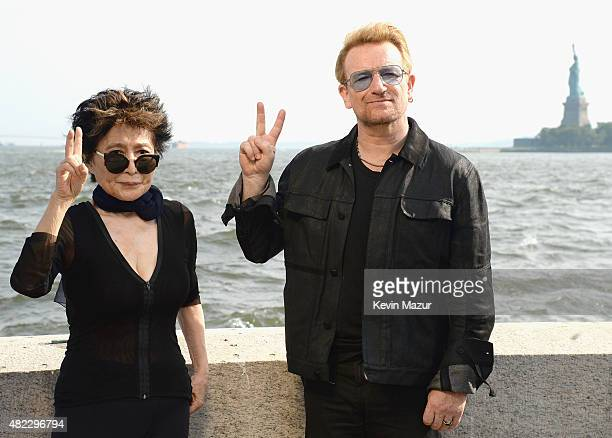 Yoko Ono and Bono attend Amnesty International Tapestry Honoring John Lennon Unveiling at Ellis Island on July 29 2015 in New York City