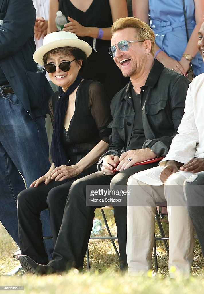 Yoko Ono (L) and Bono attend the Amnesty International Tapestry Honoring John Lennon Unveiling at Ellis Island on July 29, 2015 in New York City.
