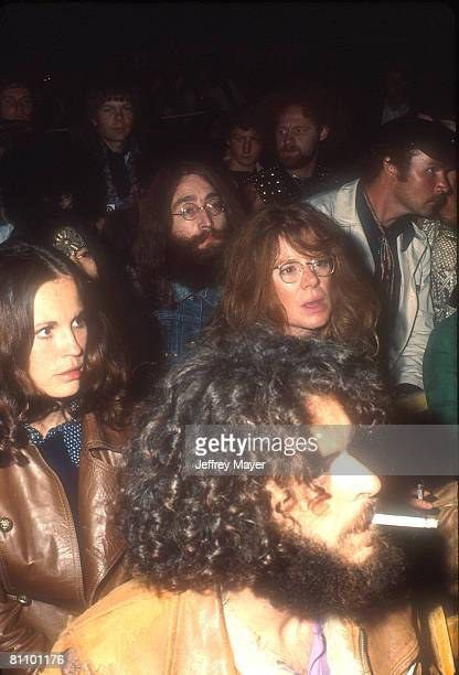 Yoko Ono and John Lennon in the audience during Bob Dylan's show at the Isle of Wight Festival 31st August 1969
