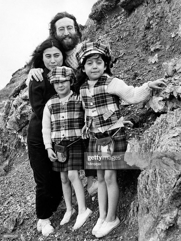 Yoko Ono And John Lennon Stand On Mountain Side With Julian Kyoko Both