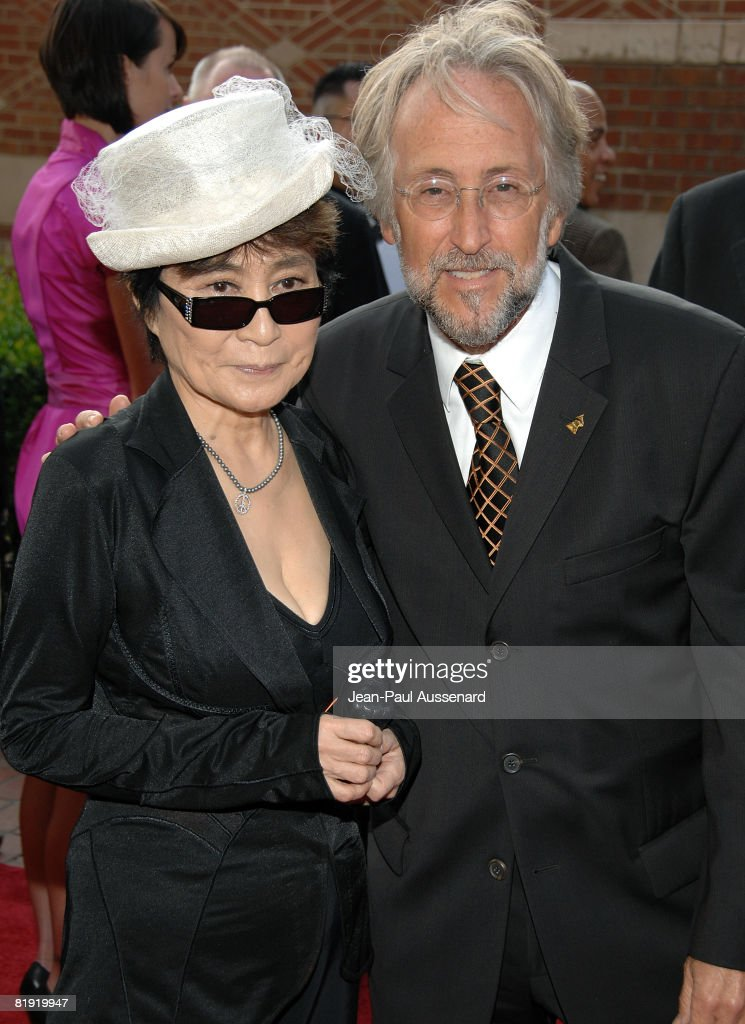 Yoko Ono and Neil Portnow arrive at the GRAMMY Foundation Starry Night held at the University of Southern California on July 12th, 2008 in Los Angeles, California.