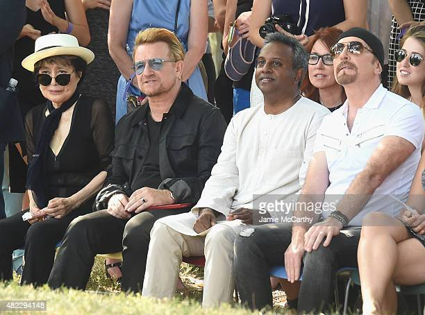 Yoko Ono Bono Secretary General Salil Shetty and Edge attend Amnesty International Tapestry Honoring John Lennon Unveiling at Ellis Island on July 29...
