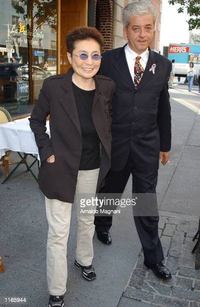 Yoko Ono leaves La Goulue resturant with her driver Koral Karsan October 3 2001 after having lunch with her daughter Kyoko Cox in New York City
