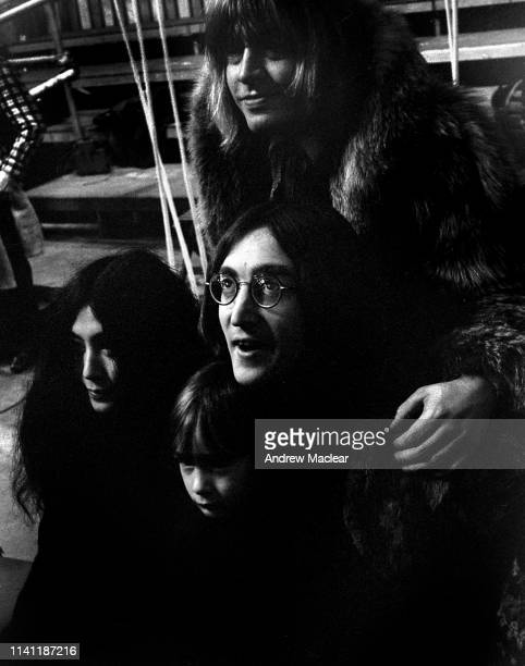 Yoko Ono pictured with Julian Lennon Brian Jones and John Lennon at the filming of 'The Rolling Stones Rock and Roll Circus' 11th December 1968