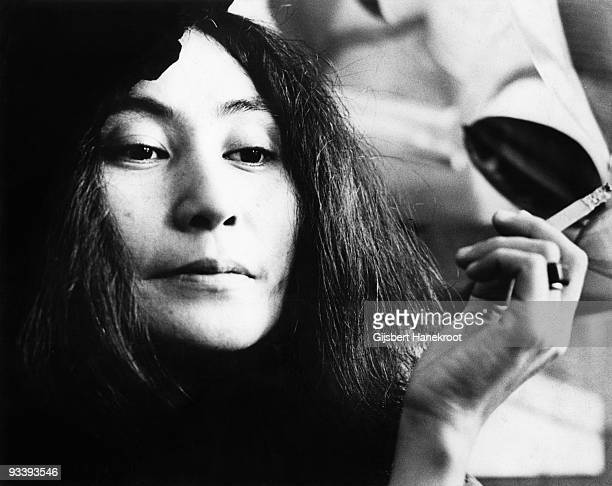 Yoko Ono posed with a cigarette in Selfridges department store Oxford Street London in 1971 to promote the publication of the 2nd edition of her book...