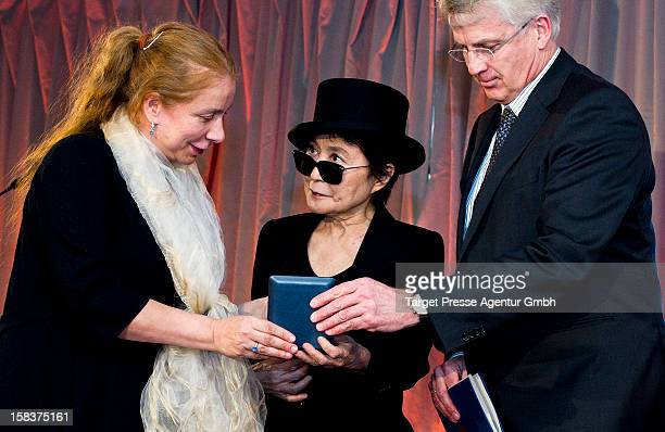 Yoko Ono receives the 'Dr Rainer Hildebrandt Medal' by Alexandra Hildebrandt at Museum Checkpoint Charlie on December 14 2012 in Berlin Germany