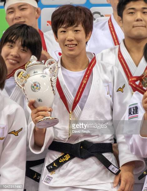 Yoko Ono shows the special porcelain trophy presented to the gold medal winning Japanese team after the team event on day eight of the 2018 Judo...