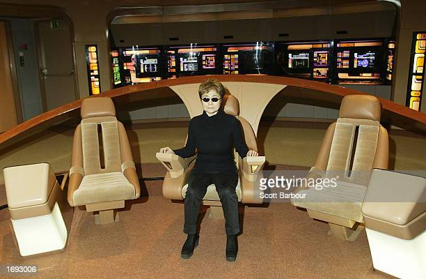 Yoko Ono sits in the captain's chair of the Starship Enterprise set at Star Trek The Adventure exhibition December 18 2002 in London England The...