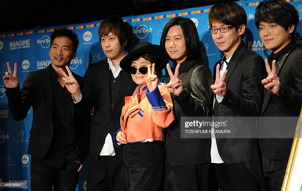 Yoko Ono, widow of the late British singer John Lennon (3rd L) poses with Taiwanese rock band Mayday, (L-R) Stone, Ashin, Masa, Ming and Monster during a photo session of the charity campaign 'Imagine There's No Hunger' in Tokyo on December 5, 2013. Ono and Mayday attended the event to support activities by WhyHunger.