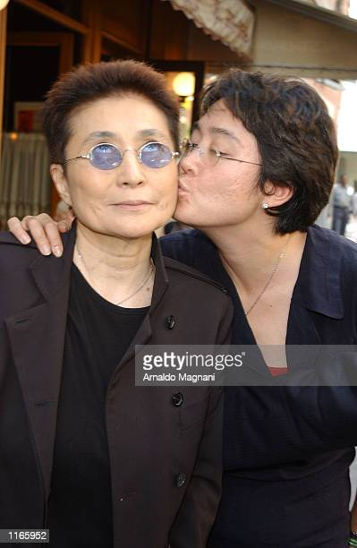 Yoko Ono's daughter Kyoko Cox gives her mother a kiss as they leave La Goulue resturant October 3 2001 after having lunch together in New York City