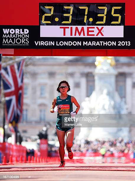 Yoko Shibui of Japan crosses the finish line in the Womens Elite section during the Virgin London Marathon 2013 on April 21 2013 in London England