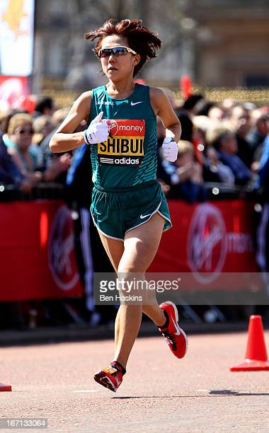 Yoko Shibui of Japan makes her way down the mall during the Virgin London Marathon 2013 on April 21 2013 in London England
