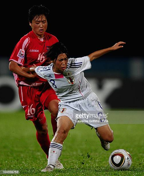 Yoko Tanaka of Japan battles with Kang Ok Gum of North Korea during the FIFA U17 Women's World Cup Semi Final match between North Korea and Japan at...