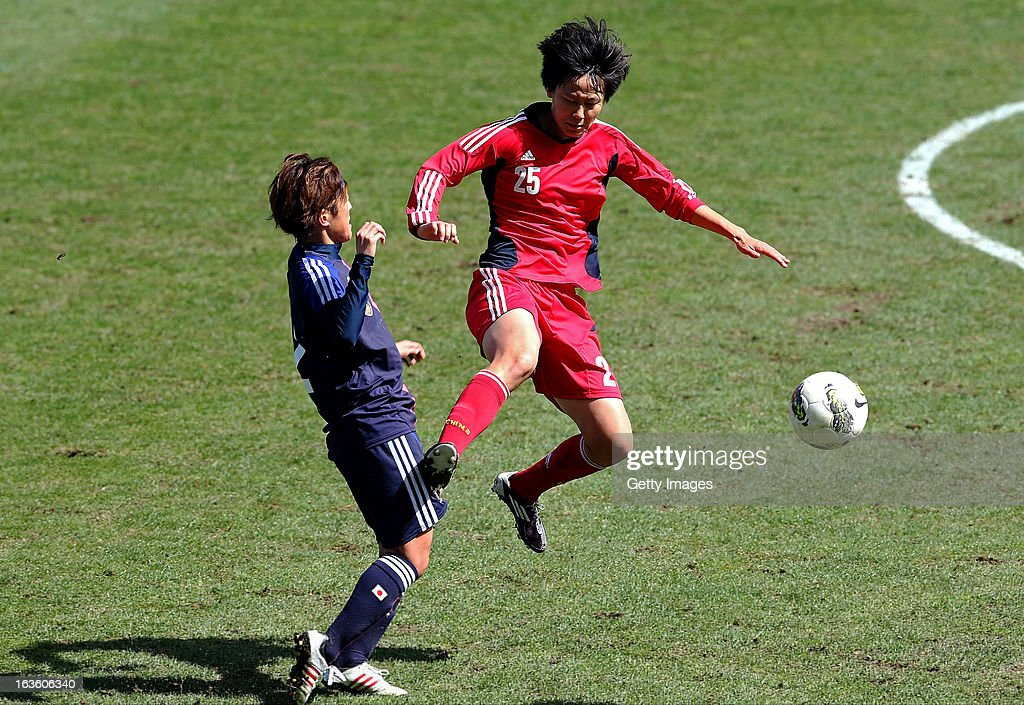 Yoko Tanaka of Japan challenges Zhang Rui of China during the Algarve Cup 2013 fifth place match at the Estadio Algarve on March 13, 2013 in Faro, Portugal.