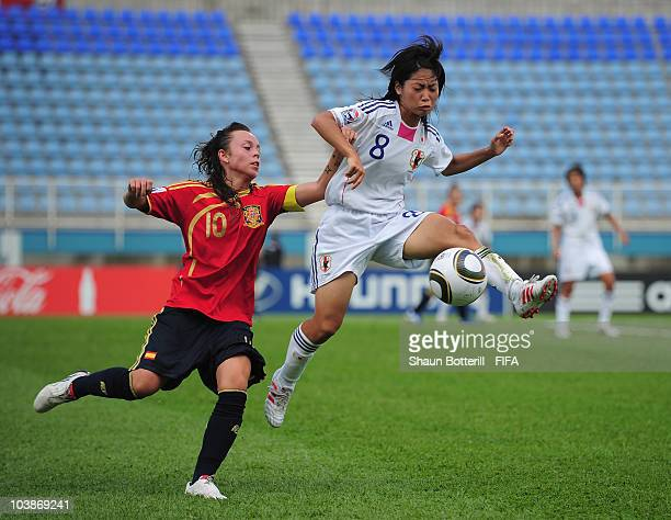 Yoko Tanaka of Japan is challenged by Amanda Sampedro of Spain during the FIFA U17 Women's World Cup Group C match between Spain and Japan at the Ato...