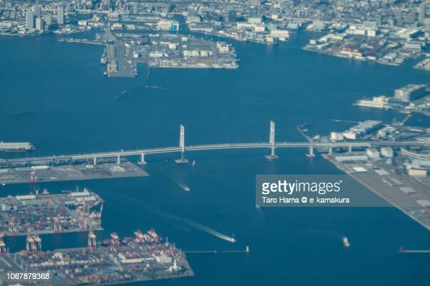 Yokohama Bay Bridge in Yokohama city in Kanagawa prefecture in Japan daytime aerial view from airplane