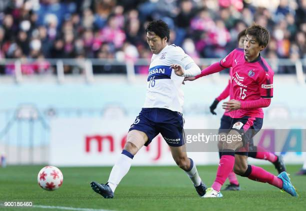 Yokohama F Marinos forward Sho Ito scores a goal past Cerezo Osaka midfielder Yasuki Kimoto during the Emperor's Cup football final between Cerezo...