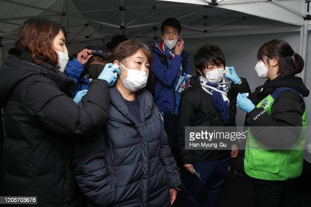 Yokohama F.Marinos fans are tested for signs of the coronavirus ahead of the AFC Champions League Group H match between Jeonbuk Hyundai Motors and...