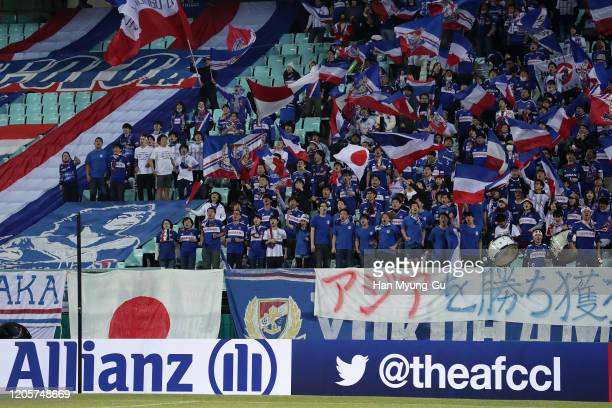 Yokohama F.Marinos fans cheer during during the AFC Champions League Group H match between Jeonbuk Hyundai Motors and Yokohama F.Marinos at Jeonju...