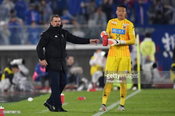 Yokohama FMarinos head coach Ange Postecoglou and Gu Sung Yun of Consadole Sapporo are seen during the JLeague J1 match between Yokohama FMarinos and...
