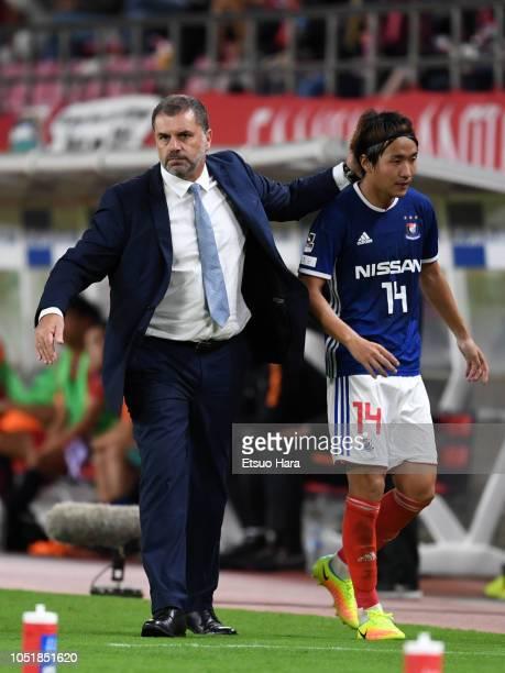Yokohama FMarinos head coach Ange Postecoglou and Jun Amano look on during the JLeague Levain Cup semi final first leg between Kashima Antlers and...