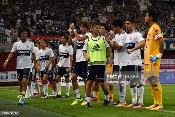 Yokohama FMarinos players applaud supporters after the scoreless draw in the JLeague match between Vissel Kobe and Yokohama FMarinos at Noevir...
