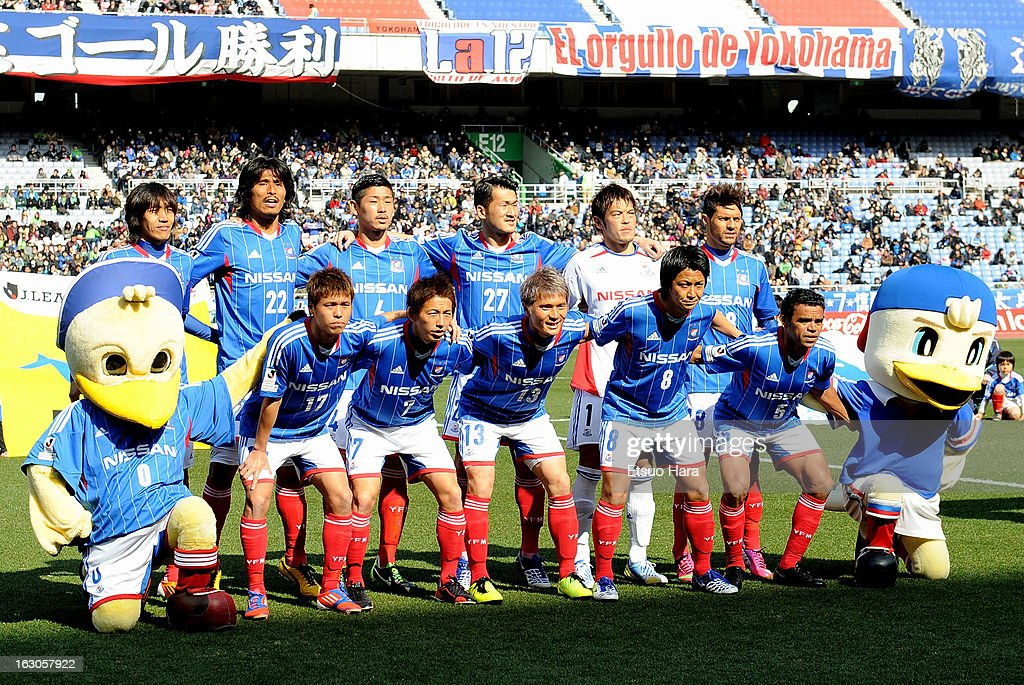 Yokohama F.Marinos players line up for the team photo prior to the J.League match between Yokohama F.Marinos and Shonan Bellmare at Nissan Stadium on March 2, 2013 in Yokohama, Kanagawa, Japan.