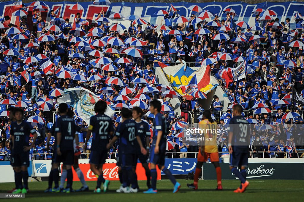 Yokohama F.Marinos supporters celebrate the win after the J.League Yamazaki Nabisco Cup match between Yokohama F.Marinos and Shimizu S-Pulse at Nippatsu Mitsuzawa Stadium on March 28, 2015 in Yokohama, Kanagawa, Japan.