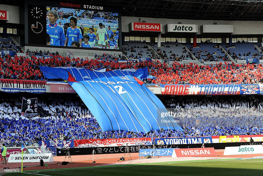 Yokohama F.Marinos supporters cheer during the J.League match between Yokohama F.Marinos and Shonan Bellmare at Nissan Stadium on March 2, 2013 in Yokohama, Kanagawa, Japan.
