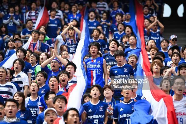 Yokohama F.Marinos supporters cheer prior to the J.League J1 match between Yokohama F.Marinos and V-Varen Nagasaki at Nissan Stadium on May 19, 2018...
