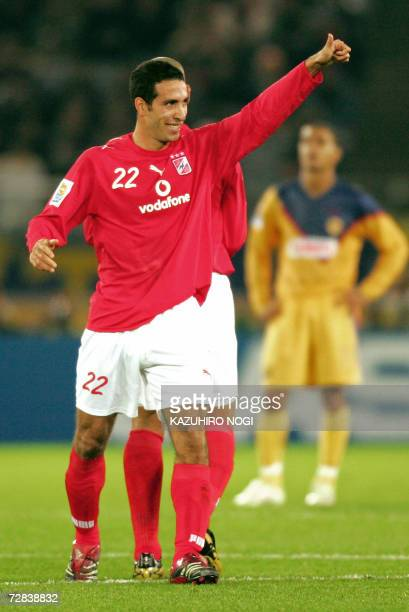 Egyptian AlAhly forward Mohamed Aboutrika reacts after scoring a free kick against Mexico's Club America during the thirdplace playoff of the FIFA...