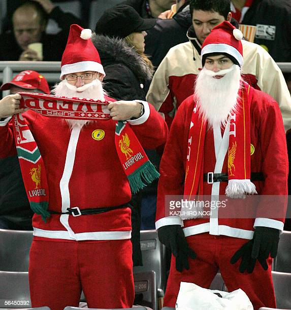 European champion England's Liverpool FC supporters dressed as Santa Claus stand disappointed during the final of the FIFA Club World Championship...