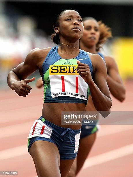 Jamaica's Sherone Simpson crosses the finish line of women's 100m dash of the Yokohama Super Track and Field meet suburban Tokyo 24 September 2006...
