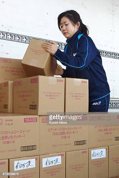 Yokohama Japan Japanese table tennis icon Ai Fukuhara load a truck with cookies and other relief supplies in Yokohama southwest of Tokyo on March 26...