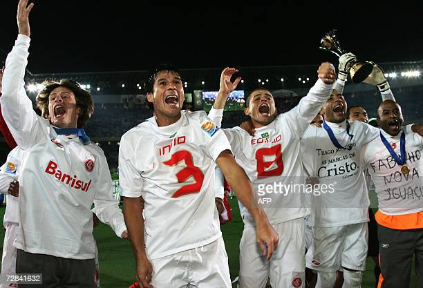 Players of Brazil's SC Internacional celebrate their victory against FC Barcelona after their final match for the FIFA Club World Cup Japan 2006 at...