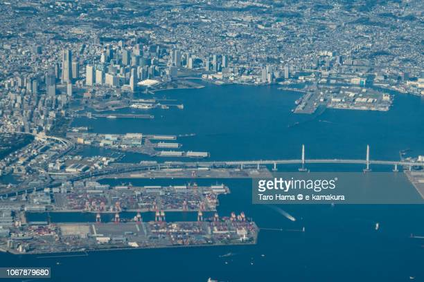 Yokohama Minato Mirai and Yokohama Bay Bridge in Yokohama city in Kanagawa prefecture in Japan daytime aerial view from airplane