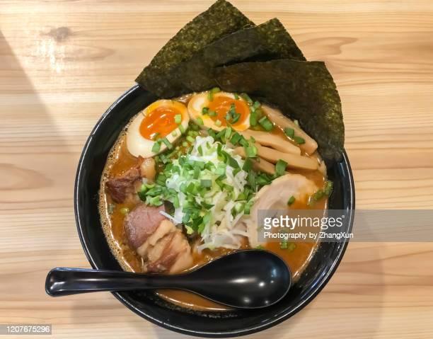 yokohama ramen served in a ramen shop in tokyo, japan. - ramen noodles stock pictures, royalty-free photos & images
