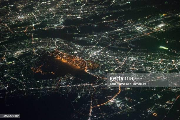 Yokota Air Base in Tokyo in Japan night time aerial view from airplane