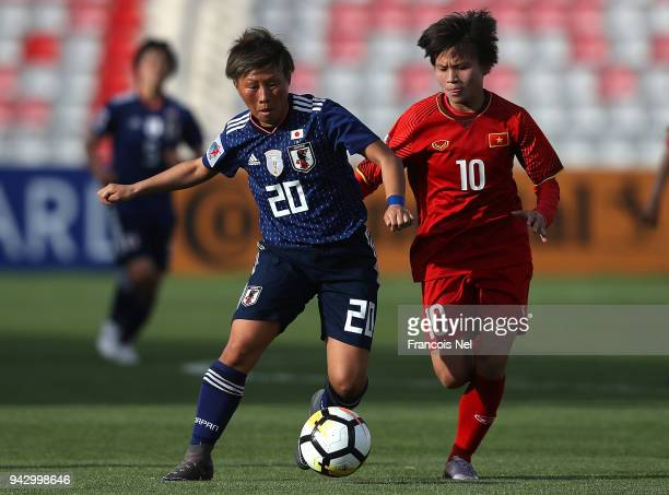 Yokoyama Kumi of Japan and Thai Thi Thao of Vietnam chase the ball during the AFC Women's Asian Cup Group B match between Japan and Vietnam at the...