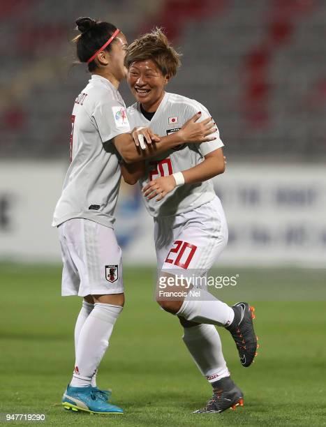 Yokoyama Kumi of Japan celebrates scoring a penalty with Nahomi Kawasumi during the AFC Women's Asian Cup semi final match between China and Japan at...