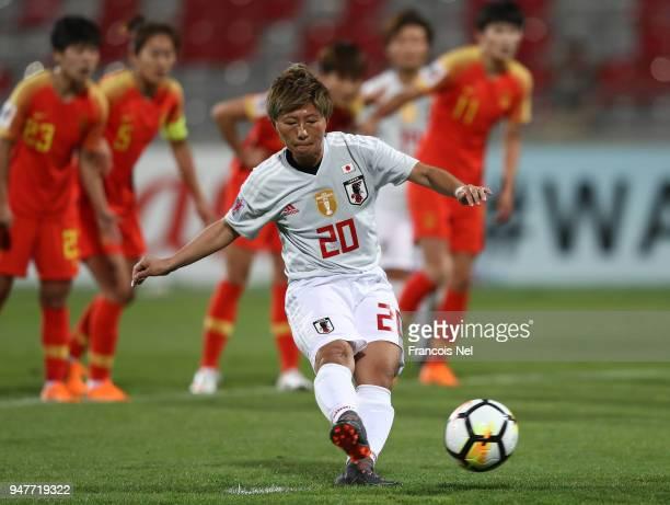 Yokoyama Kumi of Japan scores a penalty during the AFC Women's Asian Cup semi final match between China and Japan at the King Abdullah II Stadium on...