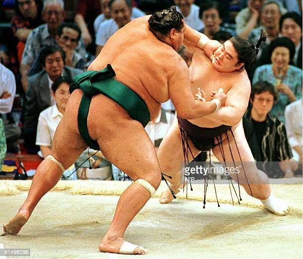 Yokozuna Akebono fights with defending champion Dejima on the 9th day of the Nagoya Grand Sumo tournament in Nagoya 17 July 2000 Akebono dumped...