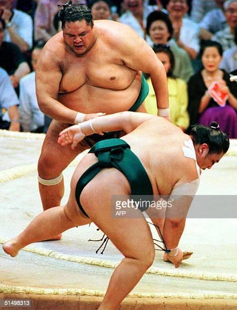 Yokozuna Akebono pushes Ozeki Miyabiyama out of the ring to win the Nagoya Grand Sumo tournament in Tokyo 21 July 2000 Akebono marked the 13th...