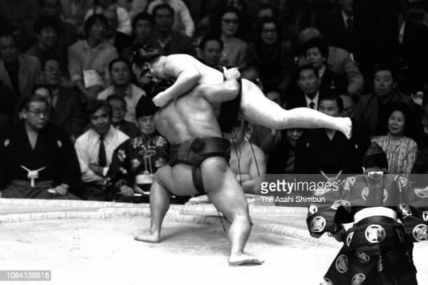 Yokozuna Chiyonofuji pushes yokozuna Takanosato to win the tournament on day fifteen of the Grand Sumo Kyushu Tournament at FUkuoka Convention Center...