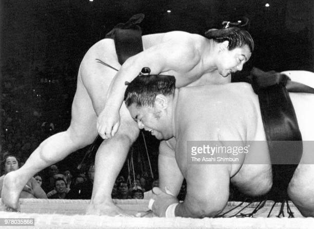 Yokozuna Chiyonofuji throws ozeki Konishiki to win on day eleven of the Grand Sumo Kyushu Tournament at Fukuoka Convention Center on November 23 1988...