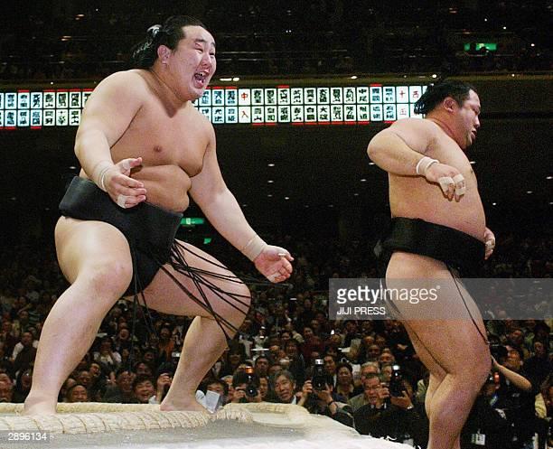 Yokozuna garnd champion Asashoryu pushes Ozeki ranked Chiyotaikai out of the ring at the 14th day bout and won the New Year Grand Sumo tournament in...