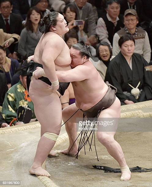 Yokozuna Hakuho of Mongolia forces compatriot ozeki Terunofuji out of the ring on the 11th day of the 15day New Year Grand Sumo Tournament at Tokyo's...