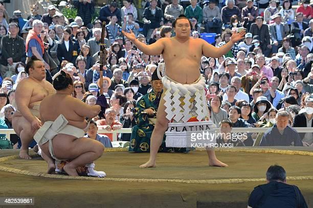 "Yokozuna Hakuho of Mongolia offers a ritual entrance into the sumo wrestling ring during a ""honozumo,"" a ceremonial sumo exhibition at Yasukuni..."