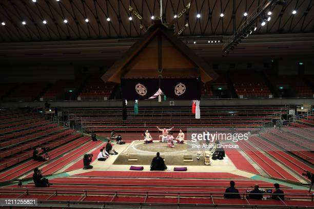 Yokozuna Hakuho performs the 'Dohyo-iri' ring purification rite on day one of the Grand Sumo Spring Tournament at Edion Arena Osaka on March 8, 2020...